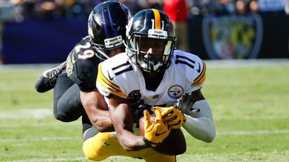 Pittsburgh Steelers wide receiver Justin Hunter (11) is stopped by Baltimore Ravens defensive back Marlon Humphrey (29) during the second half of an NFL football game in Baltimore, Sunday, Oct. 1, 2017.