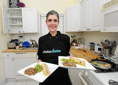 Chef Kristin Weyant of PlateDate at the Pikesville home of Murjani Greene and John Del Alcazar.