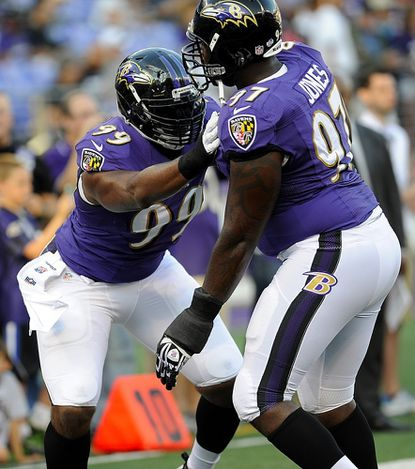 Chris Canty and Arthur Jones warm up before the Ravens' preseason win over the Falcons in Baltimore Thursday.