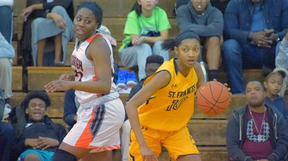 St. Frances guard-forward Angel Reese brings the ball up the court after a steal against McDonogh forward AJ Davis during a game last season. Reese said practicing ballhandling helped her become a more versatile player and one who likely will play the wing in college at Elon.