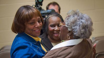 Baltimore Teachers Union president Marietta English, left, hugs volunteers at the conclusion of voting for a teachers' contract in 2010.