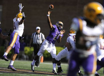 James Madison quarterback Vad Lee (2) fires a pass under mounting Albany pressure during the first half.