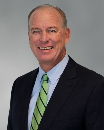 John Frederick Wilhide was executive director of Cushman & Wakefield. He specialized in the sale and leasing of industrial offices and warehouses in the Baltimore-Washington corridor.