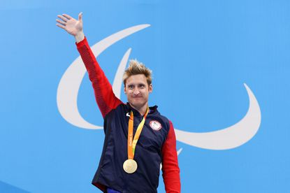 Gold medalist Brad Snyder celebrates on the podium at the medal ceremony for the men's 100-meter freestyle - S11 final.