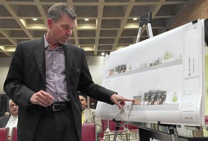 Architect Christopher Pfaeffle shows plans Tuesday for a four-story apartment building to be built next to the historic Bel Air Academy. The plans must be revamped because the Bel Air Board of Appeals denied an application for a height variance.