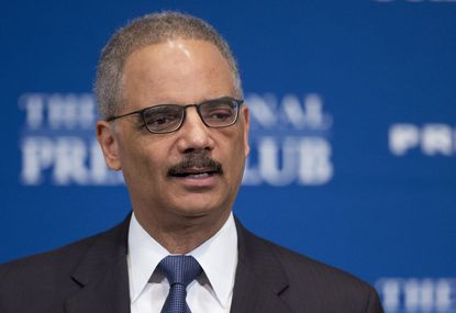 Attorney General Eric Holder speaks at the National Press Club in Washington, Feb. 17, 2015.