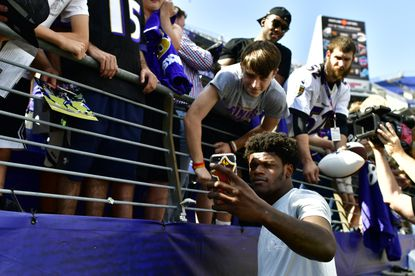 Ravens quarterback Lamar Jackson takes a selfie with a fan before a game against the Cleveland Browns, Sunday, Sept. 29, 2019, in Baltimore.