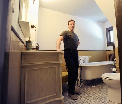 """Mike Anson, who won a """"Moxie"""" award from This Old House magazine for doing a renovation of his bathroom, some of it while on a broken ankle."""
