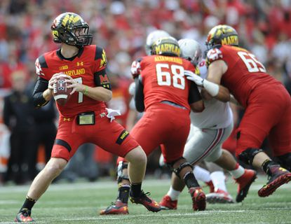 In this Oct. 4, 2014 file photo, Maryland quarterback Caleb Rowe looks to pass against Ohio State during an NCAA college football game in College Park, Md. Rowe has been named the Terps starter for their Week 3 game against South Florida.
