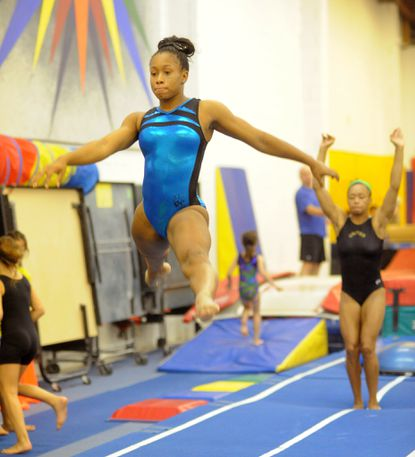 Toni-Ann Williams, 17, a former Roland Park student, practices in 2013 at United Gymnastix in Reisterstown.