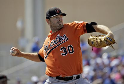 Baltimore Orioles starting pitcher Chris Tillman (30) throws against the Toronto Blue Jays during the first inning of a spring training baseball game Tuesday, March 15, 2016, in Dunedin, Fla.