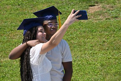 Boyfriend and Girlfriend, Jada Harris and Devin Hughes, take a selfie after graduation. The pair will atend frostburg State University in the Fall. Class of 2021 Catonsville High School graduation at SECU Arena on the campus of Towson University, 10am session, Saturday June 5, 2021.