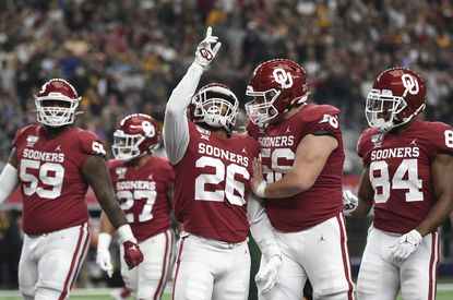 Oklahoma running back Kennedy Brooks (26) celebrates with offensive lineman Creed Humphrey (56) after rushing for a touchdown against Baylor in the Big 12 Conference championship, Saturday, Dec. 7, 2019, in Arlington, Texas.