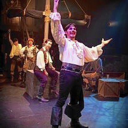 "David Jennings, in foreground, is the Pirate King in Toby's Dinner Theatre staging of ""The Pirates of Penzance."""
