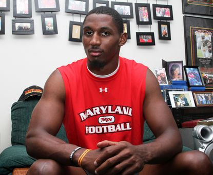 Maryland linebacker Kenny Tate poses in his home for a portrait. Tate still has hopes of playing in the NFL despite knee injuries and surgeries which have set him back.