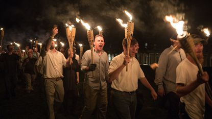 """Neo-Nazis and white nationalists brandished TIki torches as they shouted, """"Jews will not replace us,"""" in a nighttime show of strength in Charlottesville, Va., in August, 2017."""