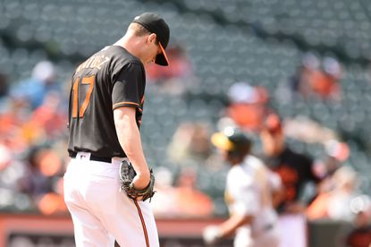 BALTIMORE, MD - MAY 7: Brian Matusz #17 of the Baltimore Orioles looks on after giving up two run home to Marcus Semien #10 of the Oakland Athletics in the eighth inning during game one of a double header baseball game at Oriole Park at Camden Yards on May 7, 2016 in Baltimore, Maryland. The Athletics won 8-4.
