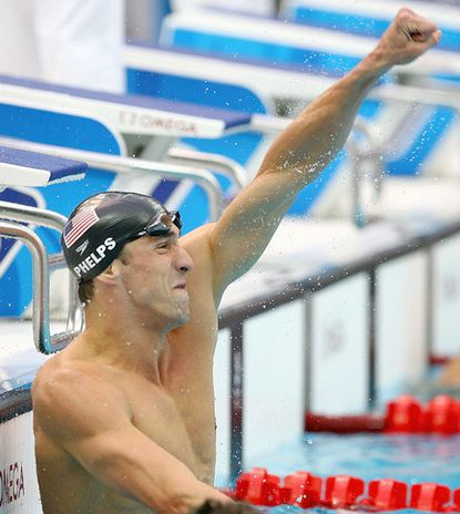 Michael Phelps wins the 100-meter butterfly at the Beijing Olympics. He would later win an eighth gold, breaking Mark Spitz's record of seven in a single Games.