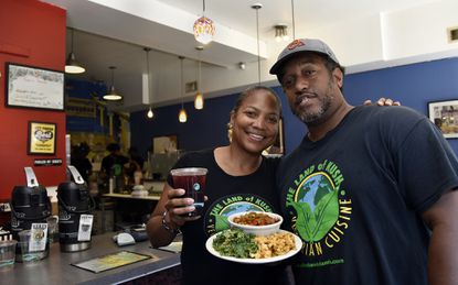 Baltimore, MD--August 26, 2016--Greg Brown, right, and his wife Naijha Wright-Brown, left, own The Land Of Kush vegetarian restaurant. Barbara Haddock Taylor