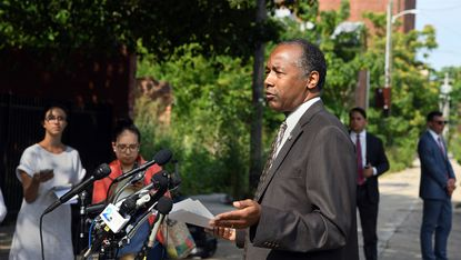 Dr. Ben Carson, Secretary of the U.S. Department of Housing and Urban Development, shown here in this file photo in West Baltimore, was cleared in a report released Tuesday by the department's inspector general's office of allegations he used his position to advance his son's business interests.