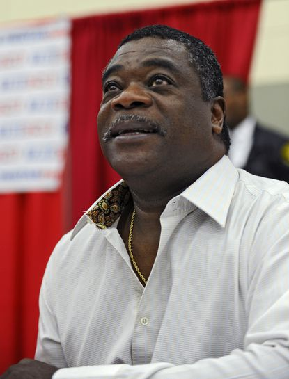 Eddie Murray greets fans during the National Sports Collectors Convention last week. He'll have his sculpture unveiled beyond center field at Camden Yards on Saturday at 5:15 p.m.