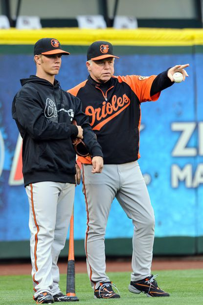 Orioles manager Buck Showalter chats with Dylan Bundy before Bundy's first major league game in Seattle.
