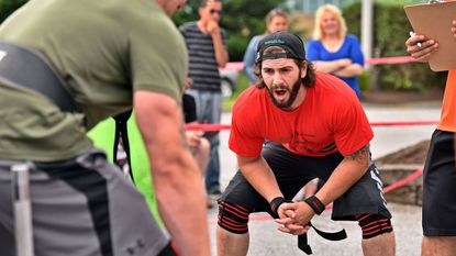 Nicolai Myers of Finksburg offers encouragement during the car dead lift event at Musclemine Gym's Rural Rumble strongman competition in Westminster on June 5, 2016. Myers won a North American Strongman national championship in November in Las Vegas.