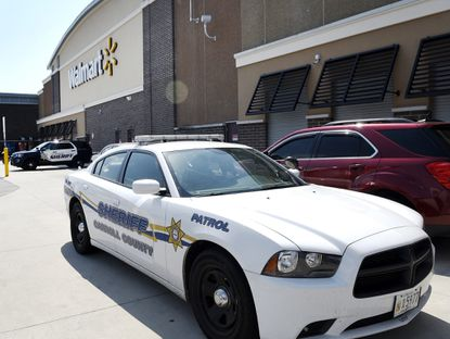 Carroll County Sheriff's Office cars are parked outside the Walmart in Eldersburg Friday morning, Aug. 9, 2019.