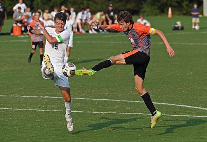 McDonogh Jacob Murrell's shot, right, is blocked by John Carroll's Eric Schultz, left, in the second half of boys soccer game. McDonogh defeated John Carroll by score of 6-0 on Sept. 13, 2021.