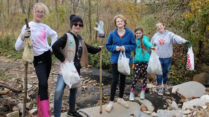 Members of Girl Scout Troop 4065 completed a cleanup of the Minebank Run Trail at Cromwell Valley Park. From left are Sarah Sterner, Erin Hoffert, Jessie Thommen, Keira Nelson and Emma Sheridan.
