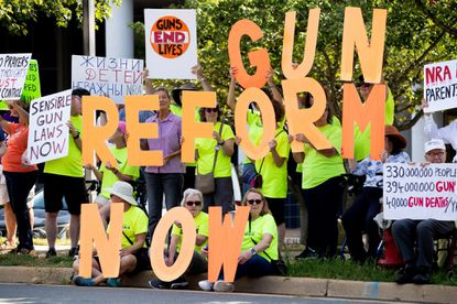 Gun reform advocates demonstrate outside the National Rifle Assn.'s headquarters in Fairfax, Va., on Wednesday. There have been renewed calls for stronger gun control laws after the recent mass shootings in El Paso and Dayton, Ohio.