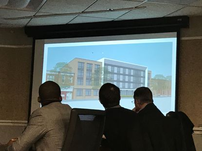 Plans for a multilevel building with retail and affordable housing units were presented Thursday to city officials.