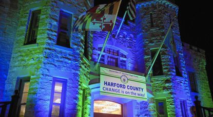 The Bel Air Reckord Armory is lit up in sky blue and grass green for Barry Glassman's victory party on general election night.
