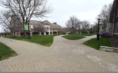 Walkways are devoid of people and campus is largely empty at McDaniel College in Westminster Tuesday, April 7, 2020.