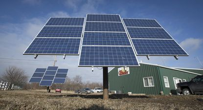 This Monday, Feb. 22, 2016 photo shows collection panels that convert sunlight to electricity, sold by CB Solar, on Lower Beaver Road in Des Moines, Iowa. (Rodney White/The Des Moines Register via AP) MANDATORY CREDIT
