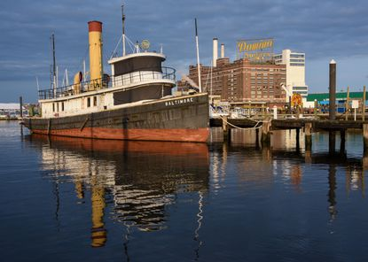 The steam tug Baltimore rests docked at the Baltimore Museum of Industry. The tugboat, the last hand-fired, coal-burning operational tug in the country, replaced its predecessor of the same name in 1906.