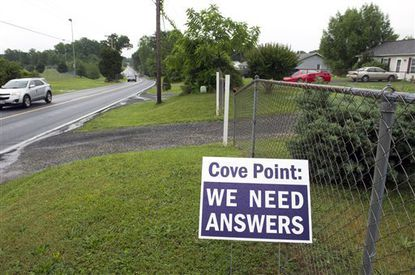 Residents concerned about the Dominion Energy's Cove Point LNG Terminal express their dissatisfaction with signs in front of their homes along Cove Point Road, near the facility in Lusby June 12.