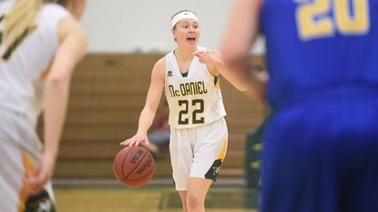 McDaniel College's Jayce Klingenberg calls a play as she controls the ball around the perimeter during a game against Goucher at McDaniel College on Jan. 3, 2019.