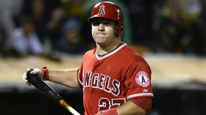 Angels outfielder Mike Trout grimaces after striking out against the Oakland Athletics on Friday. Back discomfort forced Trout to leave in the first inning of Tuesday's game against the Houston Astros