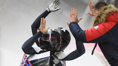 Meyers Taylor, daughter of former Navy running back, helps U.S. win silver in women's bobsled
