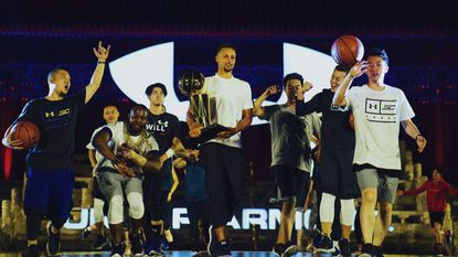 Stephen Curry at a celebration event at the historic Beijing Tai Temple complete with musical performances, an Under Armour product showcase and a fan zone including a photo opp with the Larry O'Brien Championship Trophy.