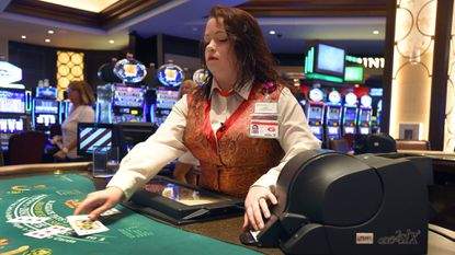 A tables games dealer at Horseshoe Casino Baltimore uses a continuous shuffling machine to deal blackjack. Since the recession, personal care and service occupations, including casino workers, has been the fastest growing jobs category in Maryland.