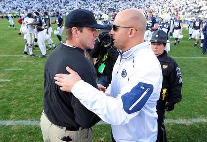 Penn State coach James Franklin congratulates Michigan's Jim Harbaugh after their game last year in State College.