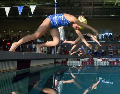 Laurel City's An Bui is off with the rest of the field as they compete in the girls, 8-and-under, 25-meter breaststroke event during the Laurel Invitational all-star swim meet at the Fairland Aquatics Swim Center on July 8.