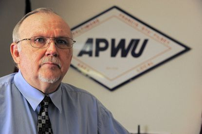 "George Askew, president of the American Postal Workers Union, Balimtore local 181, says ""the postal worker's job is definitely under attack right now."""