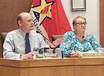 Aberdeen City Manager Randy Robertson, left, addresses the mayor and City Council Monday evening. Robertson, who was hired in 2016, recently signed a two-year contract extension that grants him a pay increase and 21 sabbatical days. He is with Phyllis Grover, city director of planning and community development.