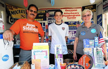 August 11, 2016: From left to right: Member of the Howard County Democratic Central Committee Nayab Siddiqui (Clarksville), Center: Volunteer Joseph Price of Elkridge, and Right: 1st Vice Chair of the Howard County Democratic Central Committee Sue Geckle (Sykesville) in action during the Howard County Fair.