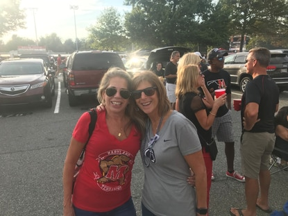 Nancy Currier, left, and Lynda Heavner are longtime friends who came to Friday's game in College Park rooting for different teams.
