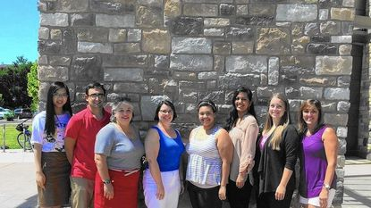 National Center for Citizen Safety Founder and President Lois Blevins, third from the left, unites with her team of volunteers, Angie Kozlowski, fourth from the left, and Susan Weilminster, right, and interns, left to right, Yixuan Wang, Matt Kerrigan, Jiselle Lopez, Mina Mathur, and Amanda Smith, in Columbia.
