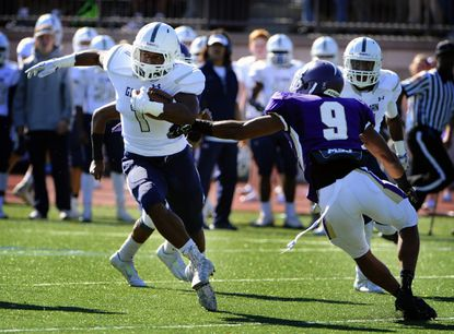 Gilman's Dorian Maddox, left, runs for yardage around Mount St. Joseph last fall. Maddox is back for Gilman, which is ranked No. 1 in the Sun's preseason Top 15 football poll.